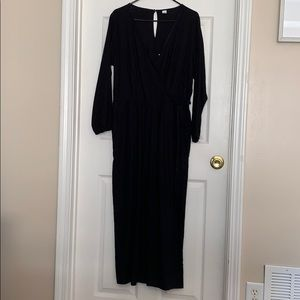 Black long sleeve jumpsuit with side tie
